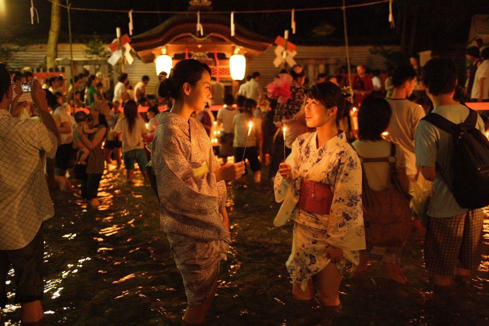 Ladies wear yukata summer kimono at Mitarashi Festival