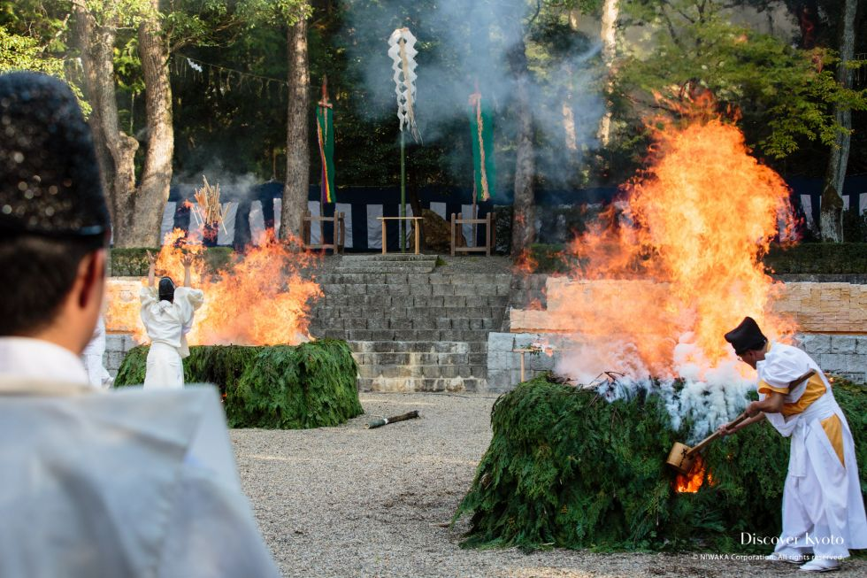 Three fires are lit during the Hitaki-sai Fire Festival at Fushimi Inari.