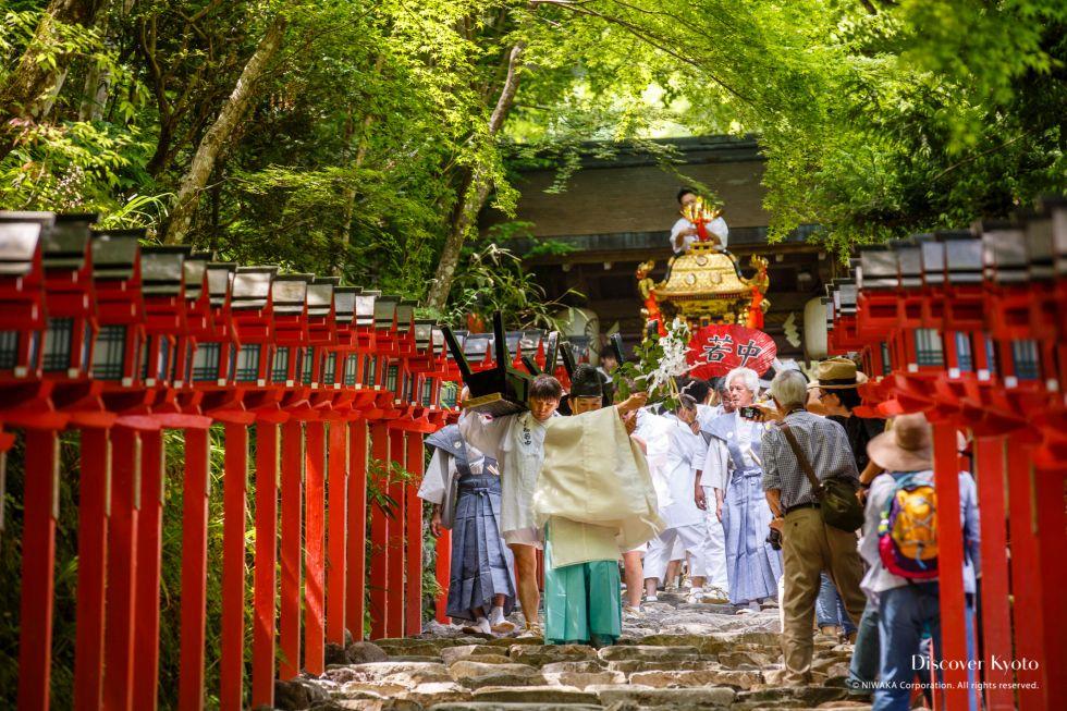 A priest cleanses the path during Kifune Matsuri at Kifune Shrine.