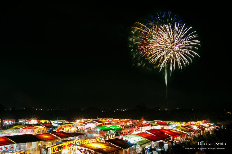 Fireworks over yatai food stalls at the 2015 Kameoka Heiwasai Hozugawa Fireworks Festival.