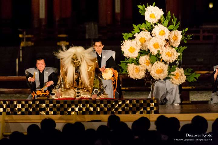 Actors on stage during Takigi Nō at Heian Shrine.