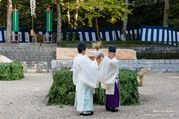 Priests offer up trays of gomagi during the Hitaki-sai Fire Festival at Fushimi Inari.