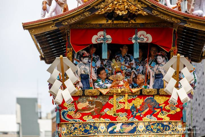 The chigo sacred child in the Naginataboko float during the Yamaboko Junkō parade of the Gion Matsuri.