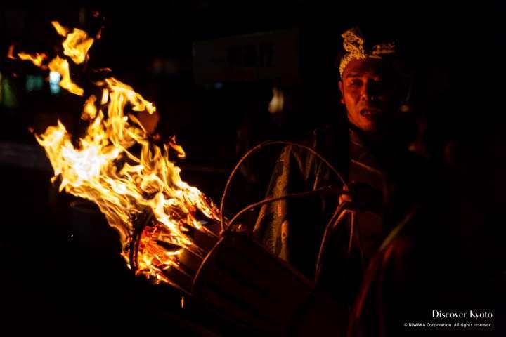 Local men carry heavy torches during the Kurama no Hi Matsuri at Yuki Shrine.