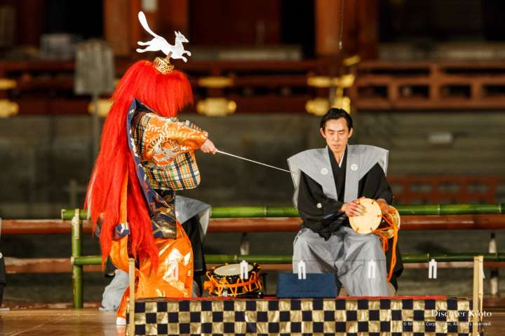 Waiving a sword at Takigi Nō at Heian Shrine.