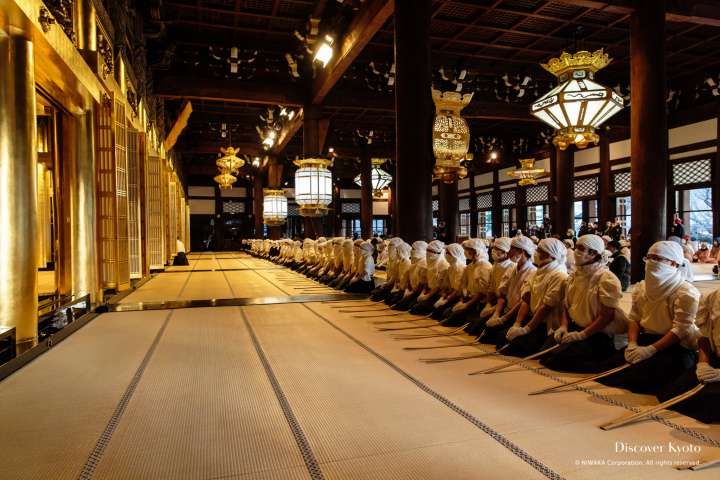 Cleaners line up during the Osusuharai at Nishi Hongan-ji.