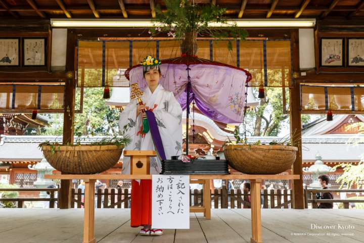 Blessings offered at Yasurai Matsuri at Imamiya Shrine.