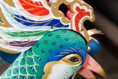 A close-up of a mythical bird at the Zuiki Matsuri at Kitano Tenmangū.