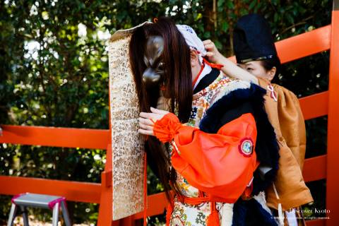 Bugaku dancer preparing during the Funeoka Taisai at Kenkun shrine.