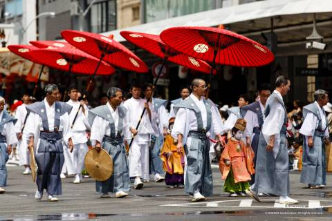 Men carrying umbrellas during the Yamaboko Junkō parade of the Gion Matsuri.