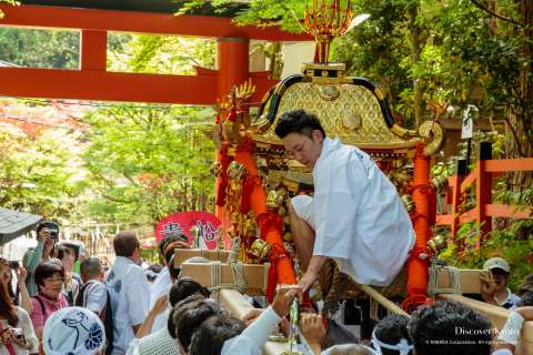 The omikoshi is carried along during Kifune Matsuri at Kifune Shrine.