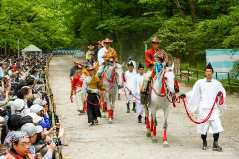 A large crowd assembles to watch the Mounted Archery Ritual at Shimogamo Shrine.