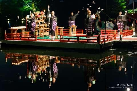 Moon-shaped wishing papers flung in the pond at the Kangetsu no Yūbe at Daikaku-ji.