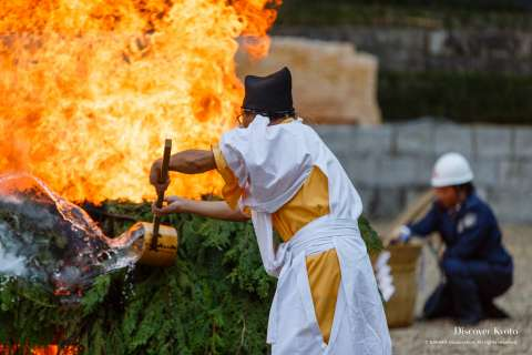 Assistants control the blaze during the Hitaki-sai Fire Festival at Fushimi Inari.