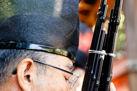 Musician and a shō, a classical Japanese instrument, during the Funeoka Taisai at Kenkun shrine.