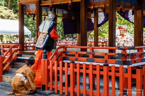 Bugaku dancer walking onto the haiden stage during the Funeoka Taisai at Kenkun shrine.