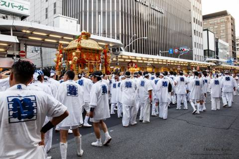 Men carry the shrine of Kushinadahime no Mikoto during the Mikoshi Procession of Gion Matsuri.