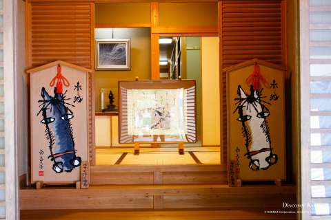 Two votive tablets featuring horses during the Mizu Matsuri at Kifune shrine.