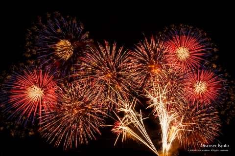 Fireworks above the Hozugawa River at the Kameoka Heiwasai Hozugawa Fireworks Festival.