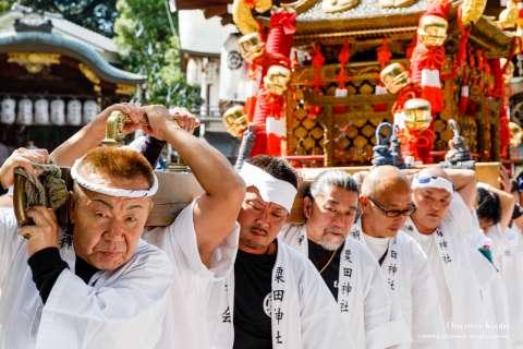 Local men carry the portable shrine during the Awata Taisai at Awata Shrine.