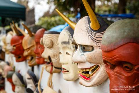 Handcrafted nō masks on sale at the 2014 Shimai Tenjin at Kitano Tenmangū.