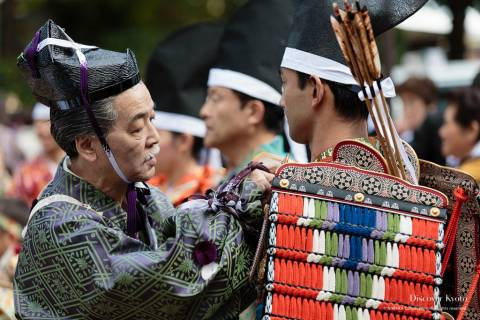 Helping a young man with his armor during the Yoroi Kizome-shiki at Kamigamo shrine.