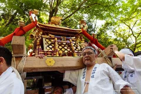 Local men participate in Kifune Matsuri at Kifune Shrine.