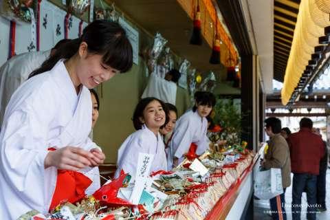 Buying charms at Tōka Ebisu at Kyoto Ebisu Shrine.