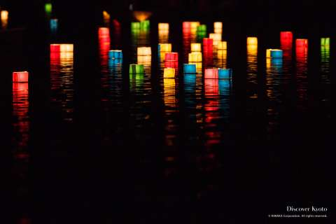 Lanterns float across the pond at the Arashiyama Gozan No Okurubi.