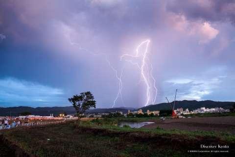 A storm rolls in before the start of the 2015 Kameoka Heiwasai Hozugawa Fireworks Festival.