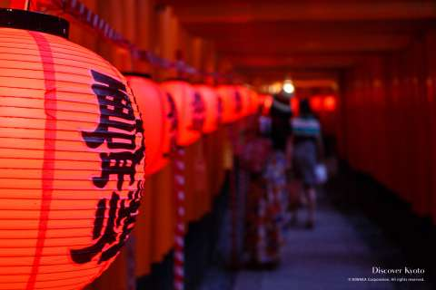 Lanterns and torii gates during the Motomiya Festival at Fushimi Inari Shrine, Kyoto.