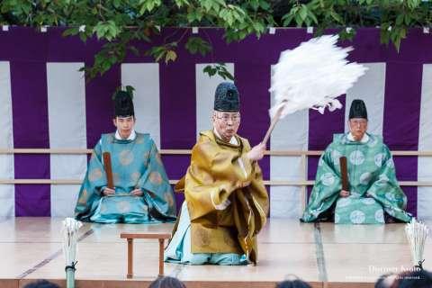 The priests of the shrine perform a ritual during the Kamigyō Takigi Nō at Shiramine Jingu.