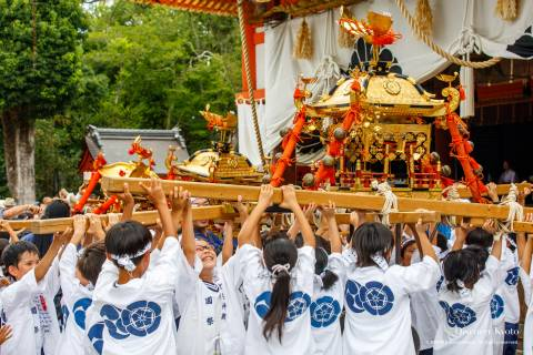 Children carrying a portable shrine during the Hanagasa Junkō at Yasaka shrine.