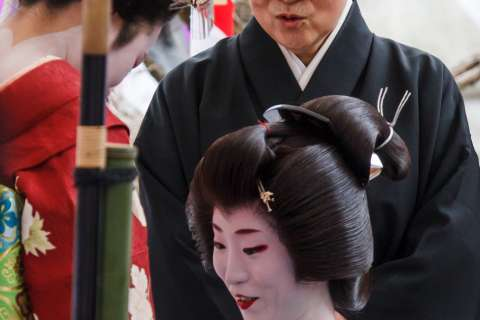 Geiko, maiko and nun during the Baikasai tea ceremony at Kitano Tenmangu shrine.