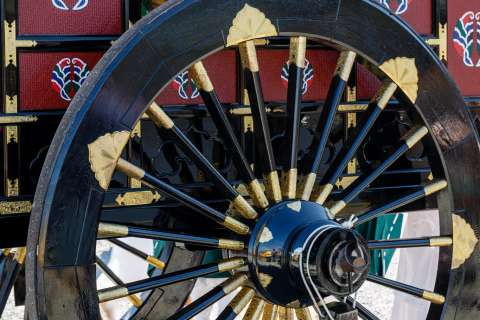 The wheel of an ox cart during the Saigū Gyōretsu at Nonomiya Shrine.