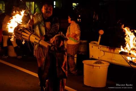 Local children carry mini torches participate in the Kurama no Hi Matsuri at Yuki Shrine.