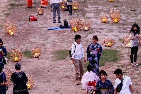 Lanterns dot the side of the Kamogawa River